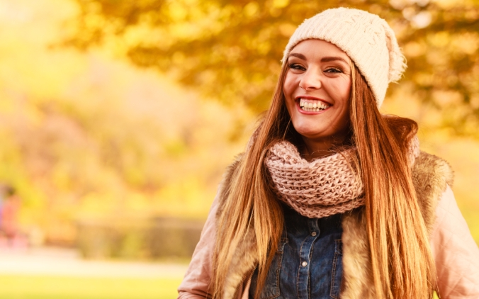 CLose up of happy woman in autumn winter