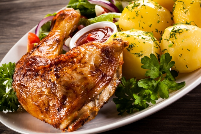 Roast chicken leg with potatoes and vegetables