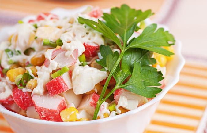 A close up of a bowl of crab salad