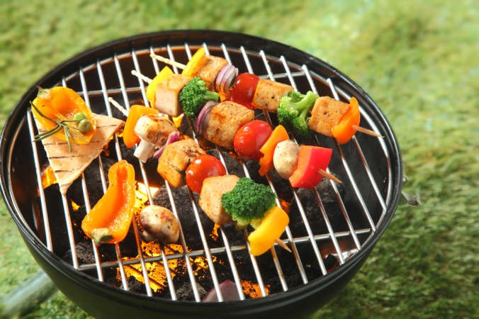 Tofu skewers with other vegetables on a barbeque