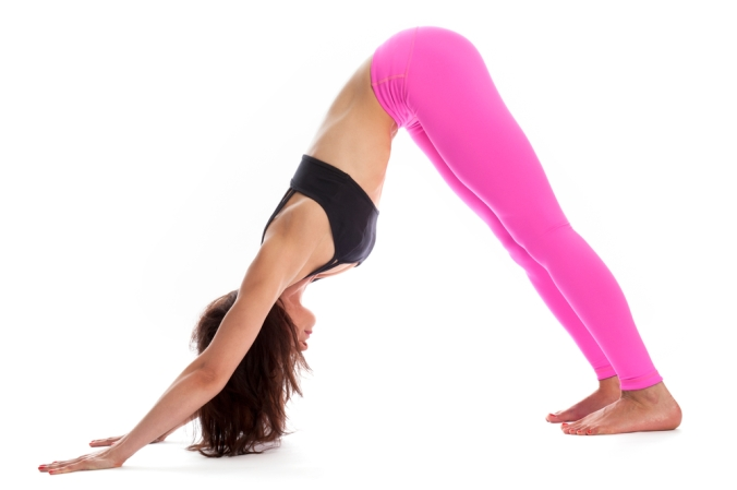 Woman in downward dog position in Yoga