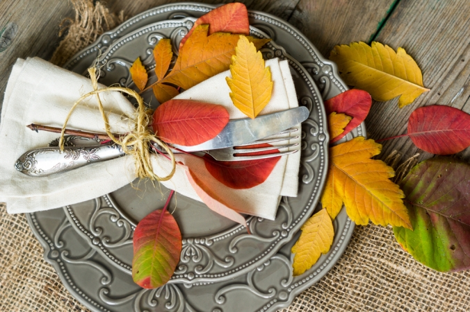 A plate with autumn leaves to represent autumn food and nutrition