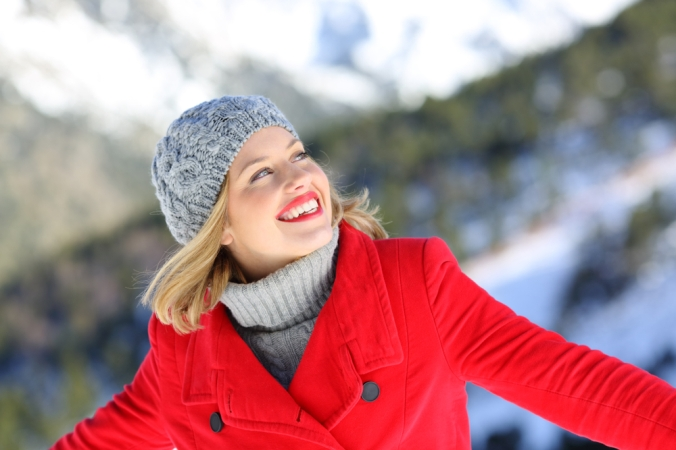 Happy woman outside in winter with energy