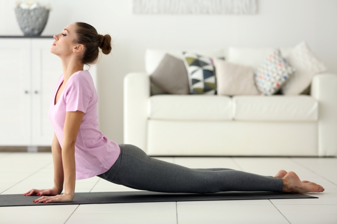 A woman practising yoga in her living room