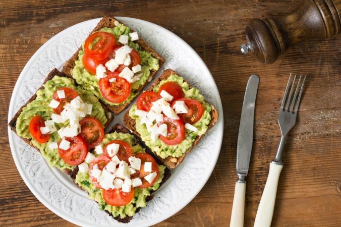Smashed avocado, cherry tomatoes and feta on toast