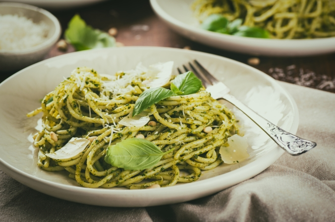 Basil and pesto pasta in a bowl