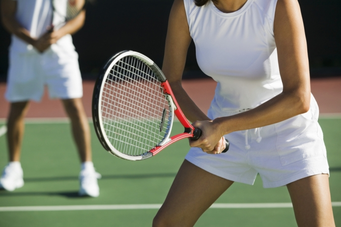 Close up of mixed doubles tennis match