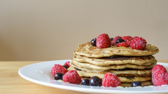 Close up of buckwheat pancakes with raspberries