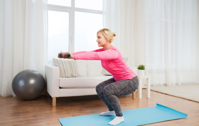 Close up of woman working out at home