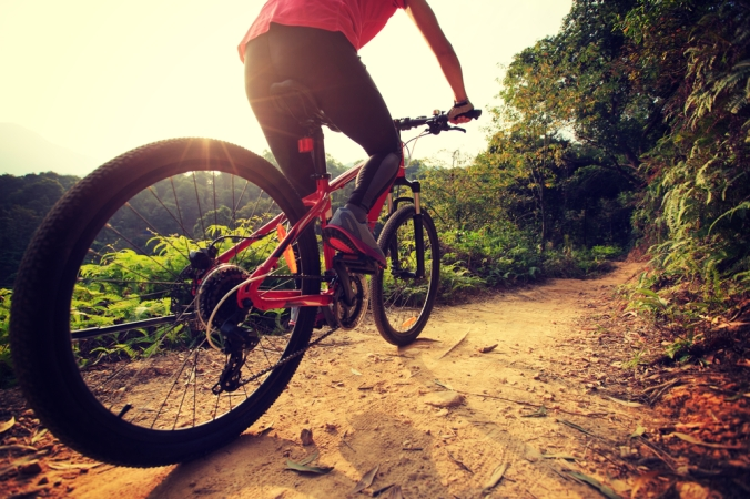 View of a woman mountain biking