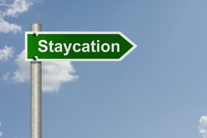 A road sign saying 'staycation'