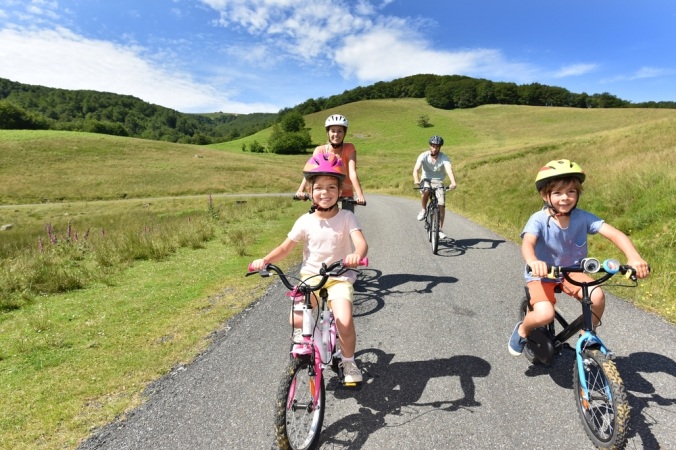 Family cycling in countryside