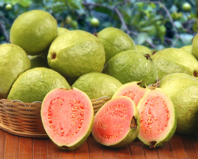 Close up of whole and halved guava fruit