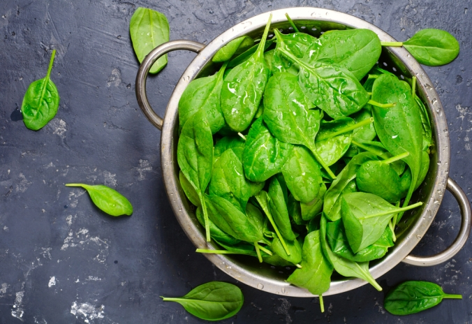 A bwol of fresh spinach leaves