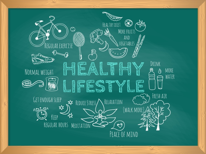 A chalk board with the words Healthy Lifestyle written on alongside other words which represent this