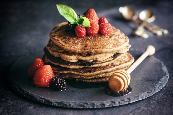Buckwheat,Pancakes,With,Berry,Fruit,And,Honey.selective,Focus