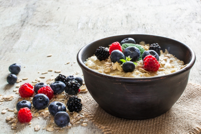 Oatmeal,Porridge,With,Berries,In,A,Bowl,On,Rustic,Wooden