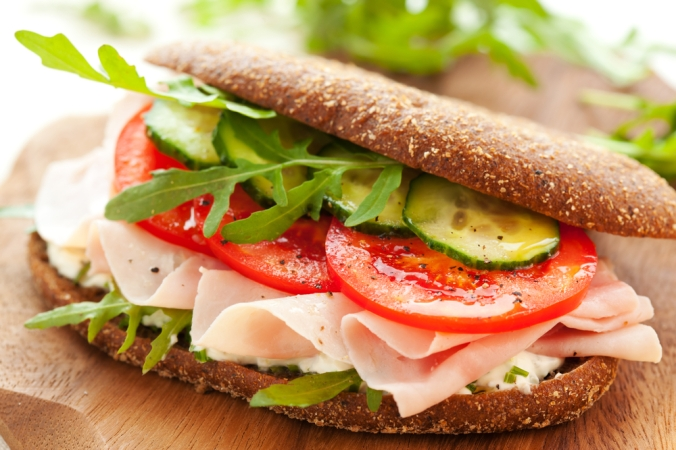 Sandwich,With,Ham,tomato,,Cucumber,And,Arugula,On,The,Wooden,Cutting