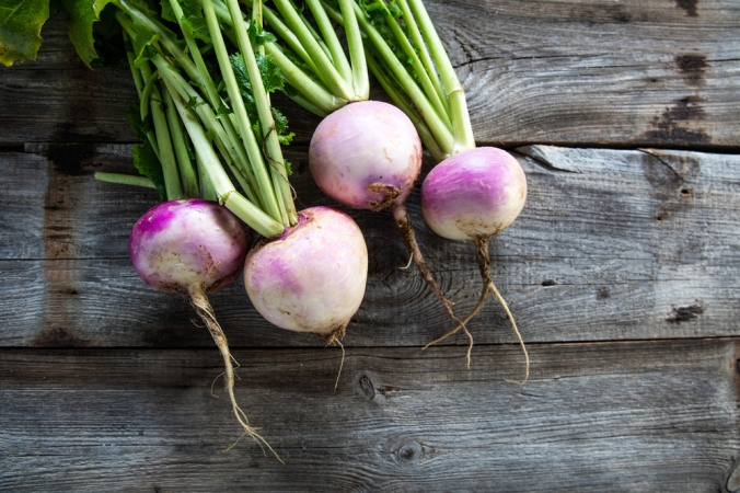 Rustic,Organic,Turnips,With,Fresh,Green,Tops,And,Roots,On